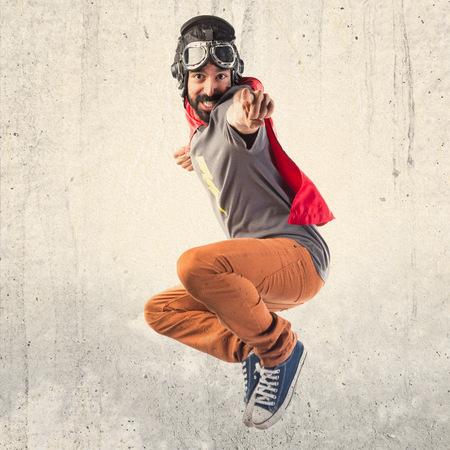 Superhero pointant vers l'avant Banque d'images - 50298371