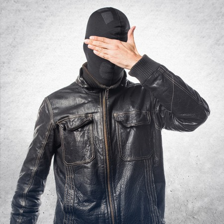 covering: Robber covering his eyes
