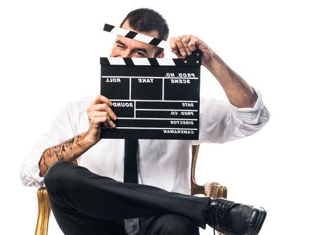 clapperboard: Businessman holding a clapperboard