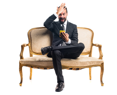 sitting on sofa: Businessman talking to mobile
