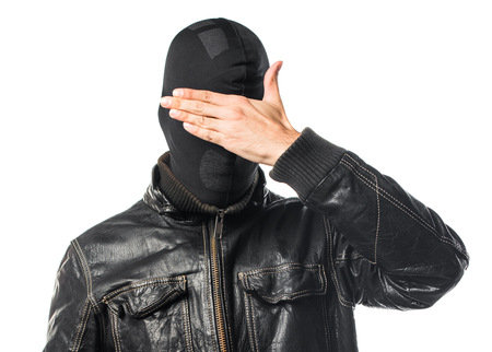gesticulate: Robber covering his eyes