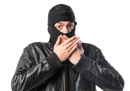 covering: Robber covering his mouth Stock Photo