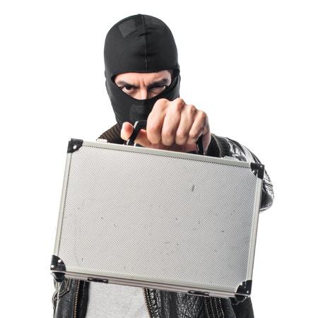 criminal case: Robber holding a briefcase Stock Photo