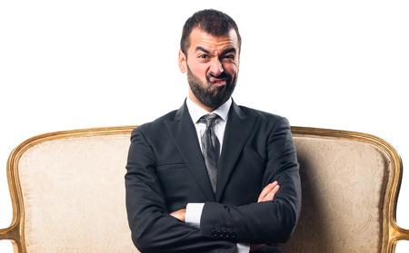 sad businessman: Sad Businessman sitting on armchair