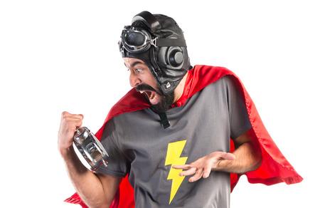 Superhero holding vintage clock