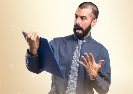 holding notes: Man holding notes Stock Photo