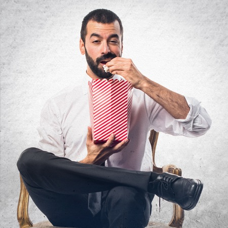 popcorn bowls: Businessman eating popcorns