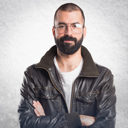 leather: Man with leather jacket with his arms crossed