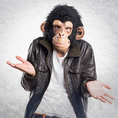 unimportant: Monkey man making unimportant gesture Stock Photo