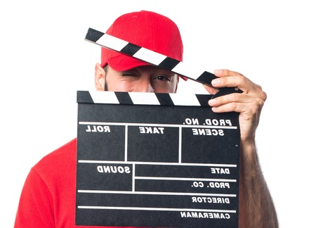 clapperboard: Pizza delivery man holding a clapperboard Stock Photo