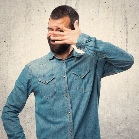 covering: Man covering his face Stock Photo