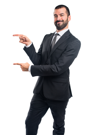 lateral: Businessman pointing to the lateral