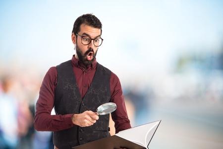waistcoat: Man wearing waistcoat with magnifying glass Stock Photo