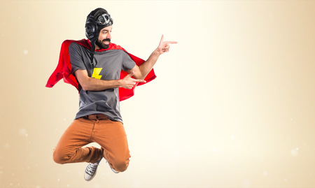 lateral: Superhero pointing to the lateral Stock Photo