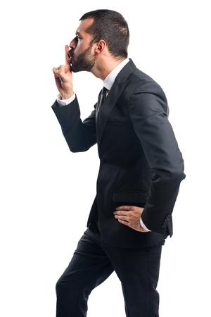silence gesture: Businessman making silence gesture