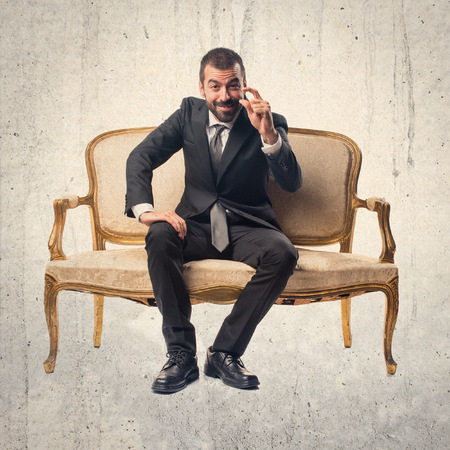 tiny: Businessman doing tiny sign Stock Photo