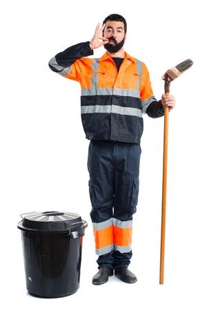 silence gesture: Garbage man making silence gesture