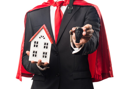 icone: Super hero businessman holding a little house