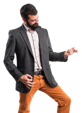 music player: Man making guitar gesture Stock Photo