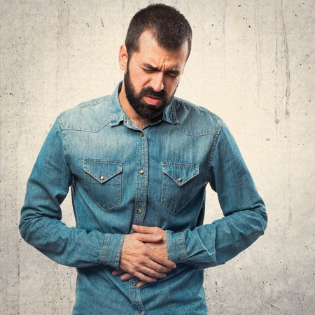 stomachache: Man with stomachache Stock Photo