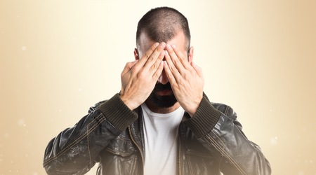 pimp: Pimp man covering his eyes