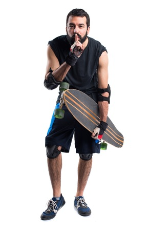 silence gesture: Skater making silence gesture