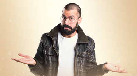 unimportant: Man with leather jacket making unimportant gesture