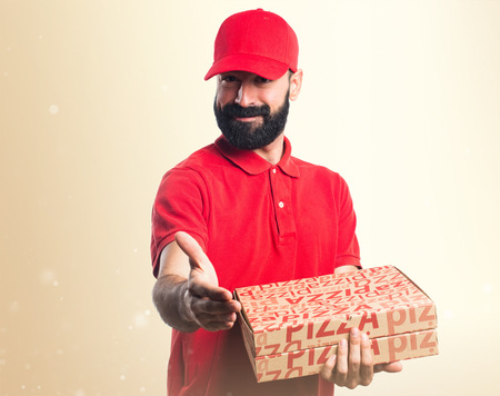 deal making: Pizza delivery man making a deal Stock Photo