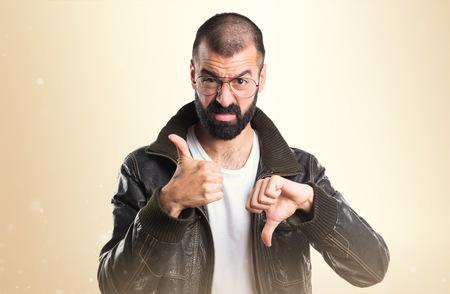 pimp: Pimp man making good-bad sign Stock Photo