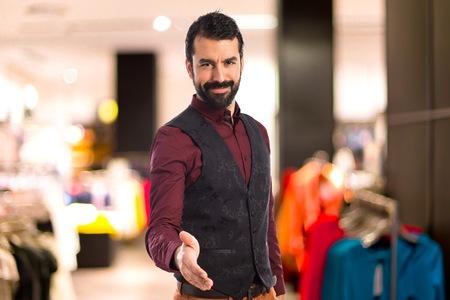 waistcoat: Man wearing waistcoat making a deal Stock Photo