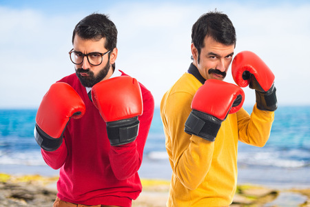 boxing glove: Twin brothers with boxing gloves