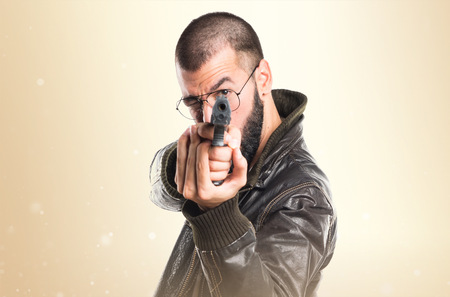 pimp: Pimp man holding a pistol