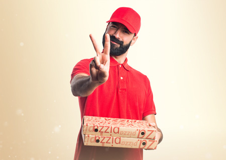 express positivity: Pizza delivery man  doing victory gesture