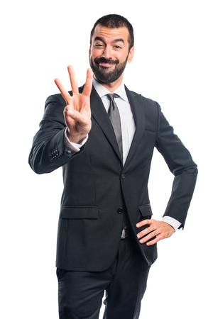 Businessman counting three