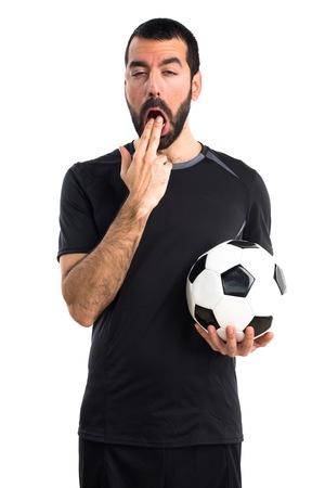 vomito: jugador de f�tbol haciendo el gesto de v�mitos