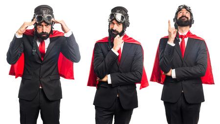 businessman thinking: Super hero businessman thinking