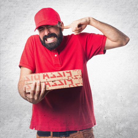 Pizza delivery man making crazy gesture