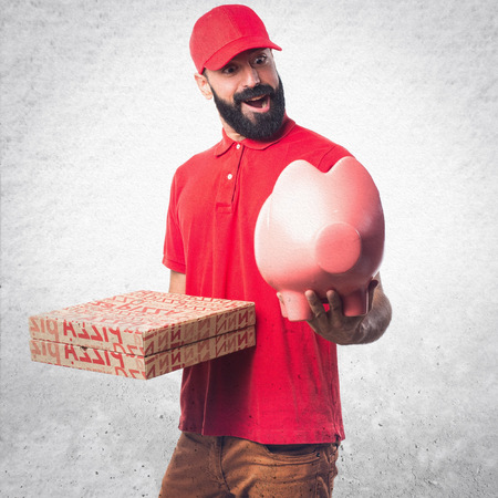coin box: Pizza delivery man holding a piggybank