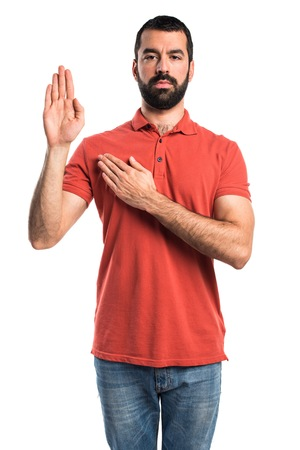 oath: Handsome man doing oath