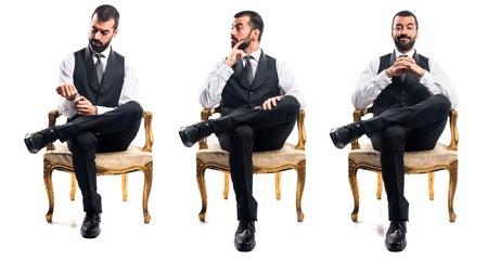persona sentada: Hombre de negocios sentado en la butaca Foto de archivo