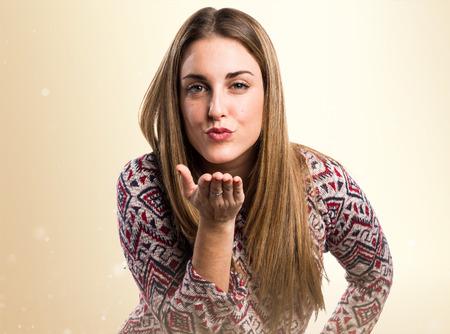 blonde hispanic: Woman sending a kiss