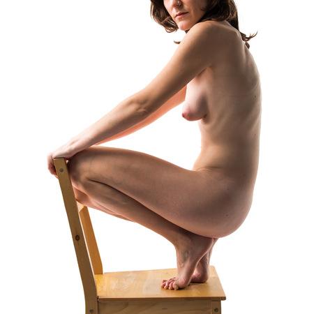 nudity: Nude woman on chair