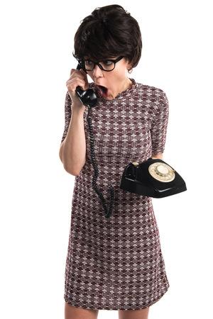vintage look: Girl with vintage look talking to vintage phone