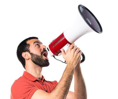 Apuesto hombre gritando por megáfono Foto de archivo