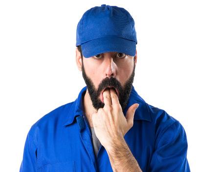 vomiting: Plumber doing vomiting gesture Stock Photo