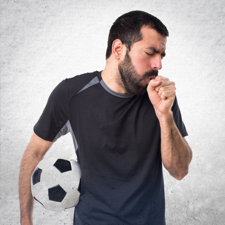 coughing: Football player coughing a lot