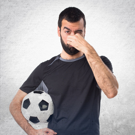 Football player making smelling bad gesture