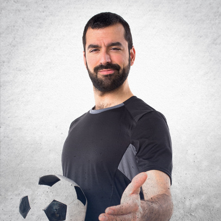 deal making: Football player making a deal Stock Photo