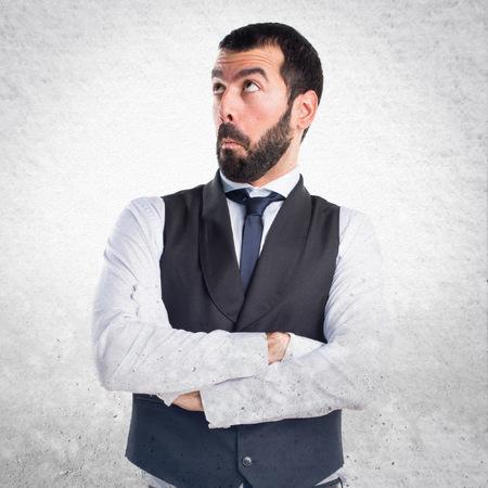 unimportant: Luxury waiter making unimportant gesture