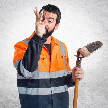 tongue cleaner: Garbage man doing a joke Stock Photo